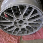 clear coated bare aluminum wheel