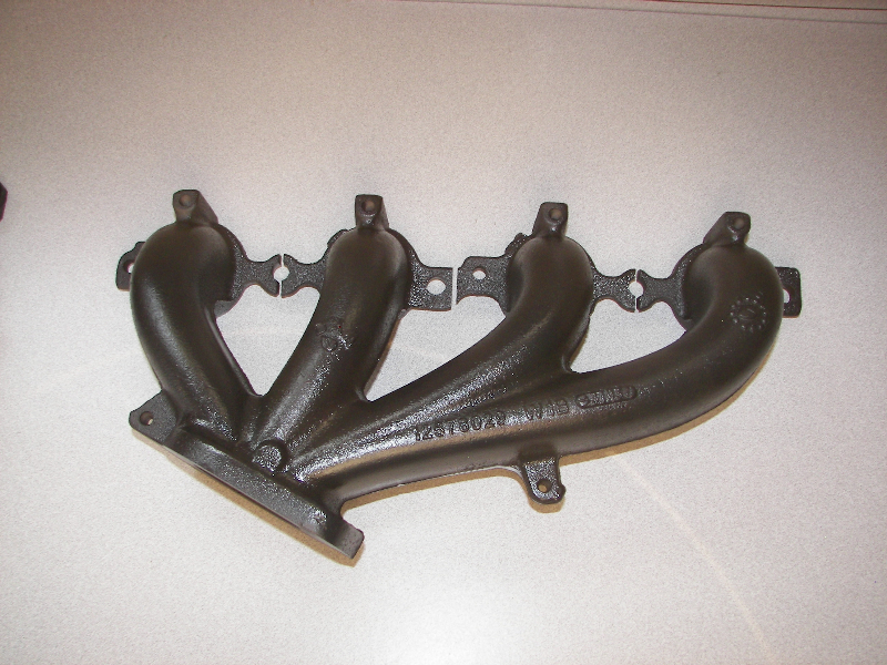 Black ceramic on cast iron header