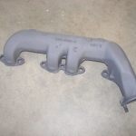 Cast iron header coated in cast iron ceramic