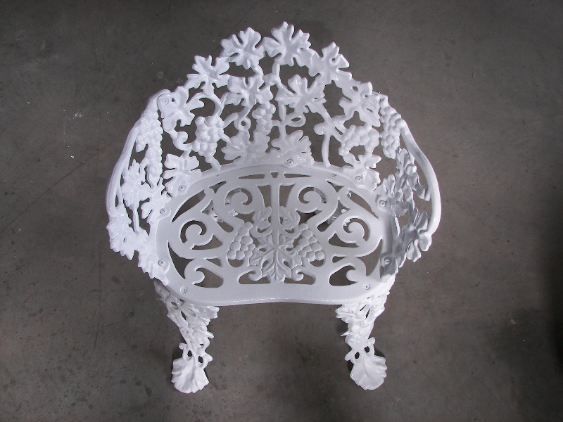 80 year old cast iron chair in wet white.