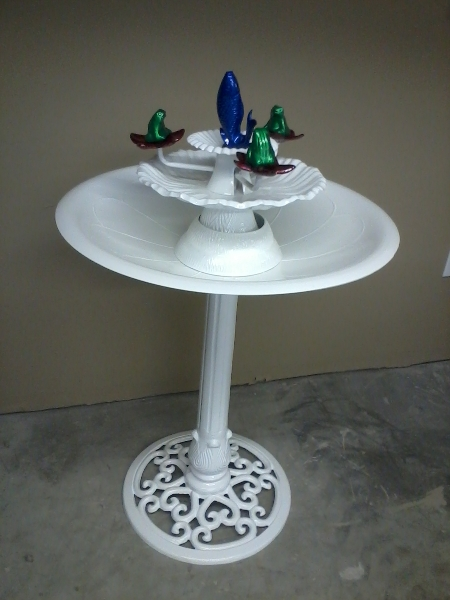Bird bath with candy blue, candy red, and translucent green over silver sparkle