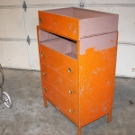 Old metal dresser with bad paint and rust