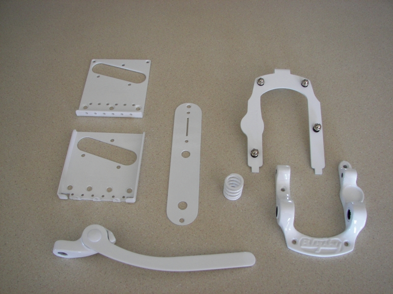 Fender guitar parts in glossy white