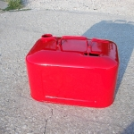 Vintage boat gas tank in wet red