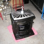 Stove after refinishing in black ceramic and chrome powder