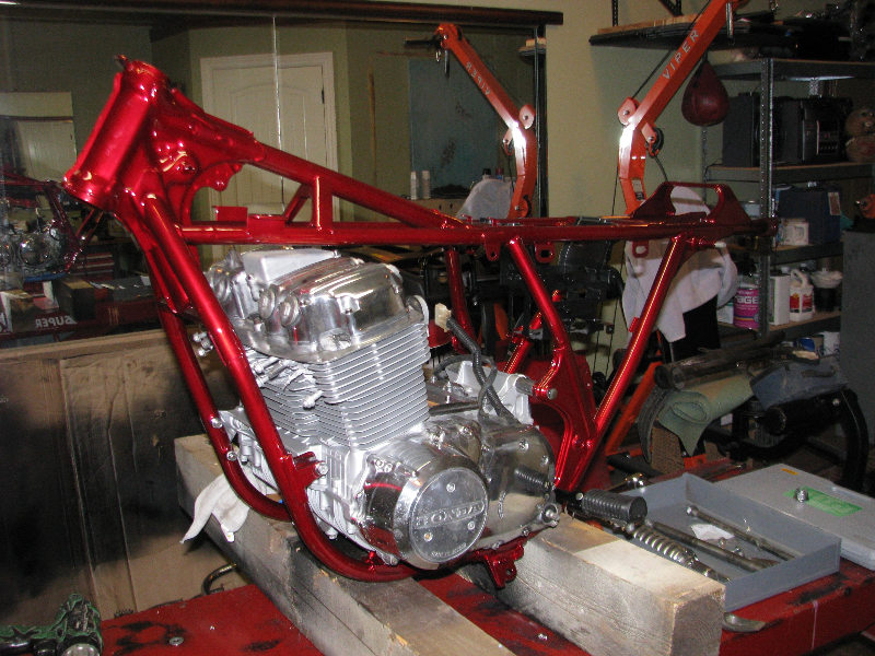 Honda CB750 frame in silver metal flake covered in candy red