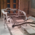 pontiac frame on lift in sandblast booth