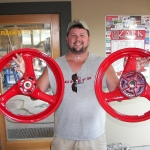 A happy customer with a set of 600 Katana wheels in wet red.