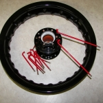 Black hub & rim with red spokes and chrome nipples - Be creative!